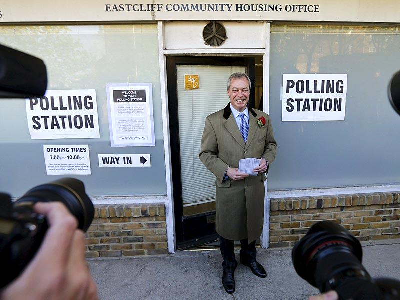 Nigel Farage, leader of the United Kingdom Independence Party (UKIP), arrives to vote at his polling station in Ramsgate, southeast England. (Reuters)