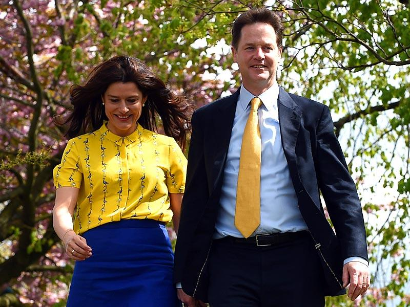 Leader of the Liberal Democrat party Nick Clegg (R) and his wife Miriam Gonzalez Durantez arrive to vote at Hall Park centre polling station in Sheffield, England. (AFP Photo)