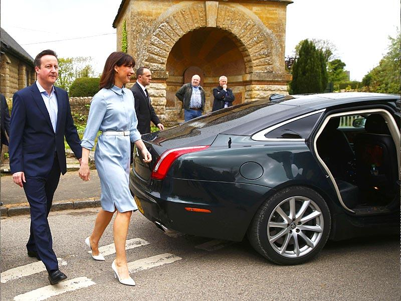 Britain's Prime Minister David Cameron and his wife Samantha leave a polling station after voting in Spelsbury, central England. (Reuters)