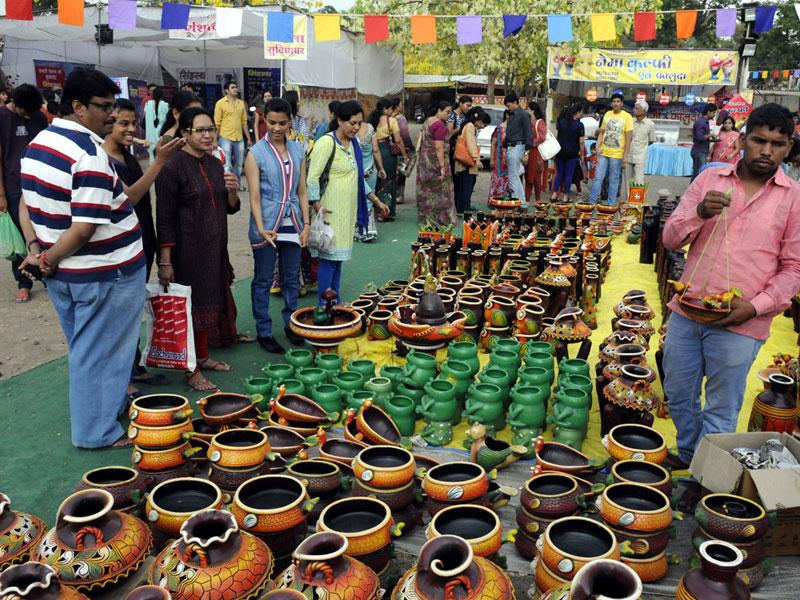 People visit the stalls set up at Malwa Utsav, in Indore on Saturday. (Arun Mondhe/HT photo)
