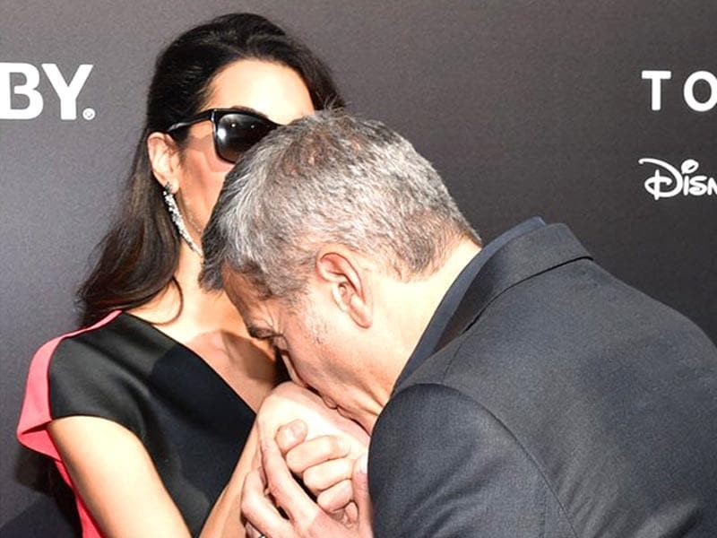 No more a ladies man, George Clooney has eyes only for wife Amal now. Just to prove the point, we saw the family man kissing Amal's hand at the Tomorrowland premiere. (Reuters photo)