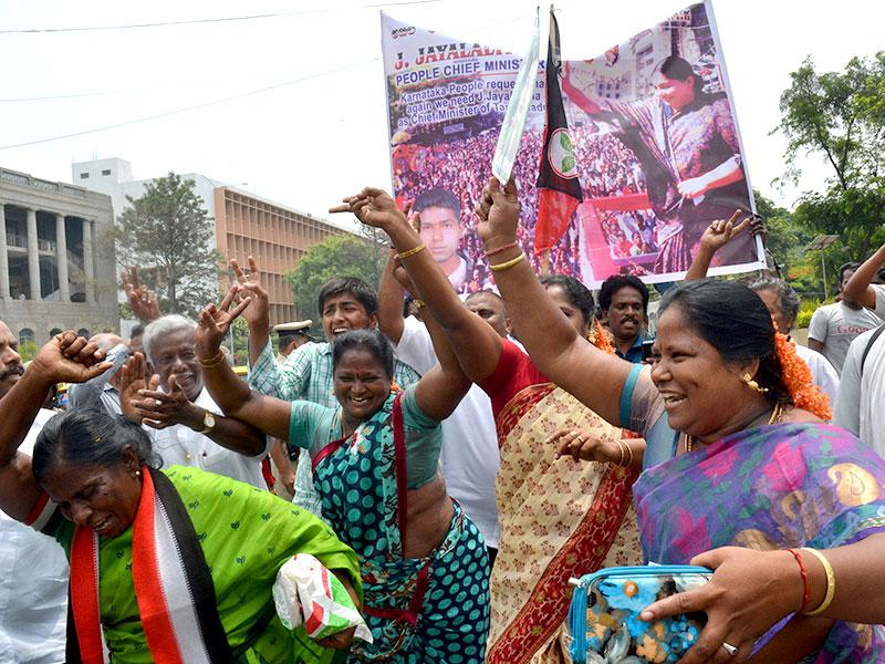 Supporters of J Jayalalithaa, AIADMK chief, celebrate after the verdict in a corruption case went in her favour. (HT Photo/Kashif Masood)