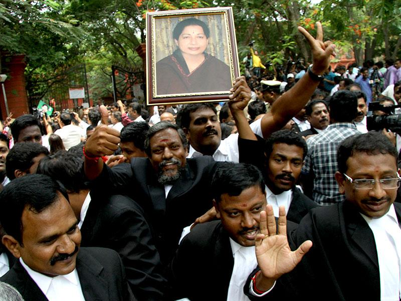 Supporters of J Jayalalithaa, AIADMK chief, celebrate outside the Karnataka High Court. (HT Photo/Kashif Masood)