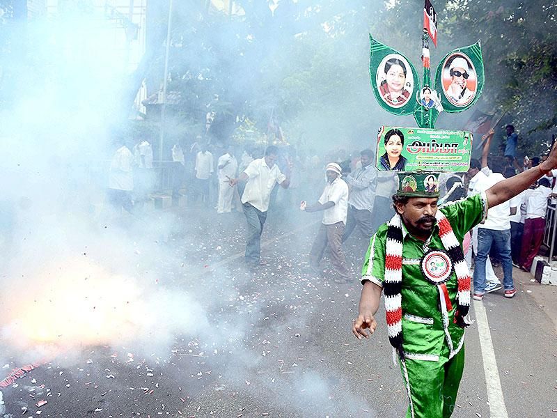 All India Anna Dravida Munnetra Kazhagam (AIADMK) party cadres celebrate Jayalalithaa's acquittal outside her residence in Chennai. (AFP Photo)