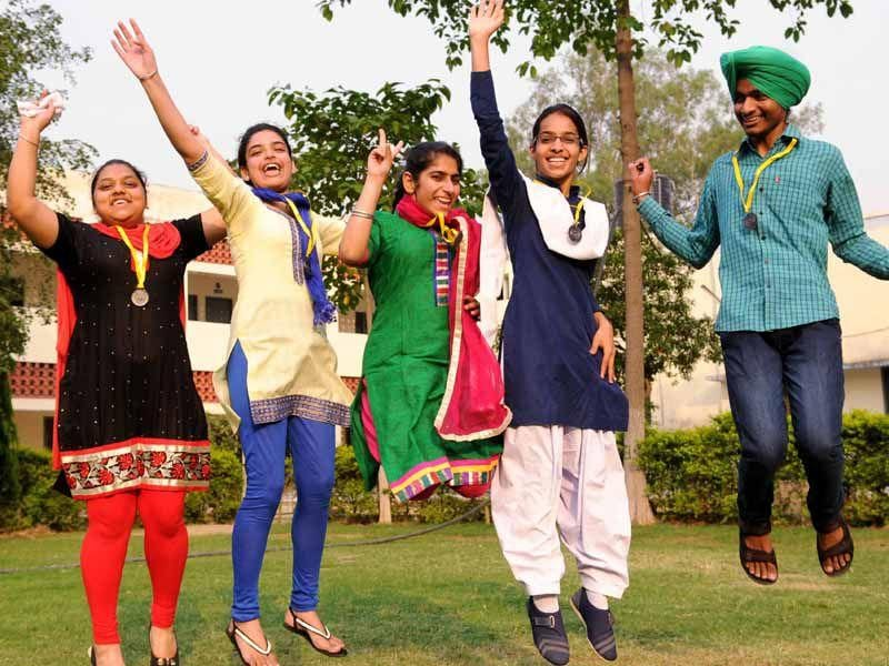 Students of Class 12 in jubilant mood after the declaration of the PSEB result in Patiala on Monday. Bharat Bhushan/HT