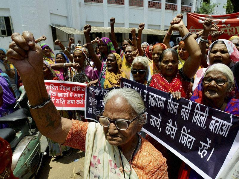 Bhopal gas survivors stage a protest at District Collectorate demanding social security pensions, in Bhopal on Tuesday. (PTI photo)