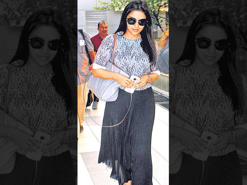 Breezy style: Fancy a more relaxed look? Take inspiration from Asin and go for a pleated chiffon skirt or a comfy pair of palazzos. Add an element of style with strappy sandals.