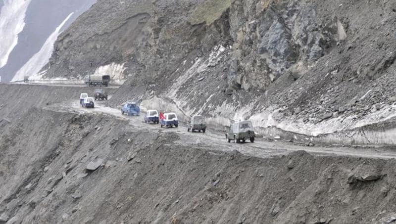 Army vehicles passing through Zojila pass, 108 kms east of Srinagar. The Srinagar-Leh road link was thrown open for vehicular traffic after around four months.Waseem Andrabi/HT