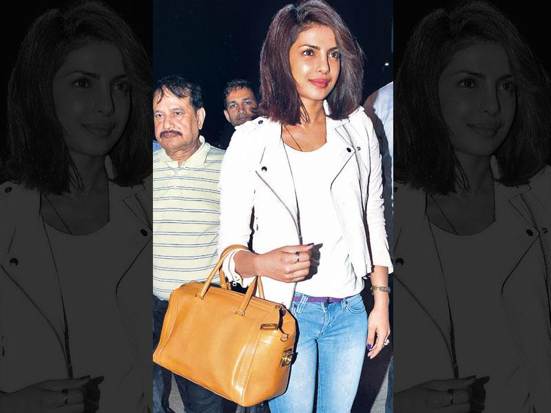 Comfy attire - check. Stylish sunglasses - check. Roomy shoulder bag - check. Take cue from these Bollywood ladies, who were spotted acing their airport style game. (Text: Shruti Dargan) Cropped 'n' stylish: Trust Priyanka Chopra to marry style with comfort. The actor amped her white cropped jacket and denim look with a mustard handbag and stylish grey boots. Take cue, as a tote ain't the only choice when travelling!