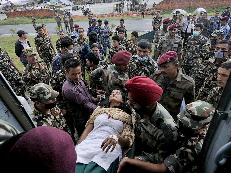 Earthquake victims being received at Kathmandu airport by Nepali army and Indian Air Force. (Burhaan Kinu/ HT Photo)