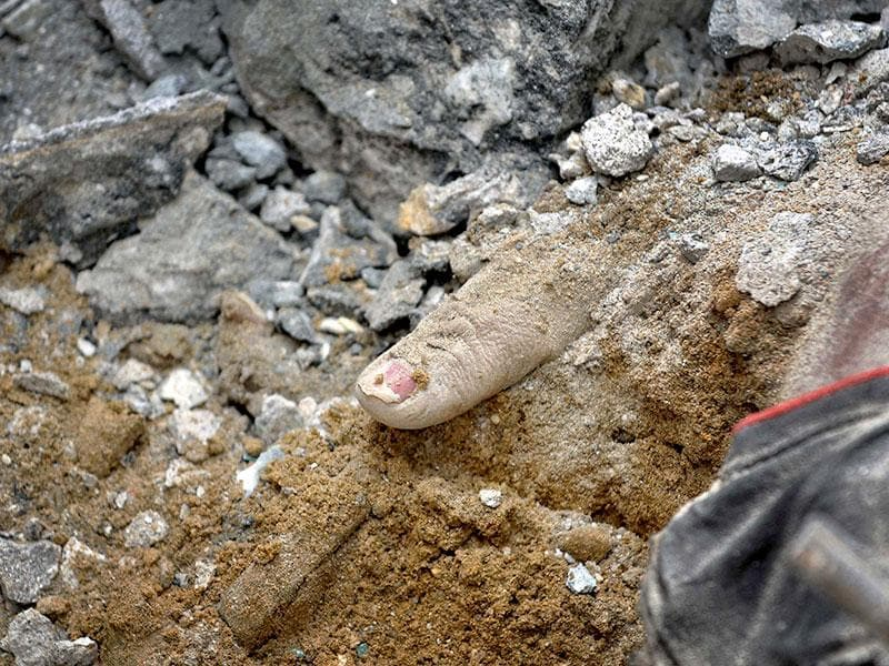 A hand is seen in the quake debris after a fresh temblor hit Nepal. (Burhaan Kinu/ HT Photo)