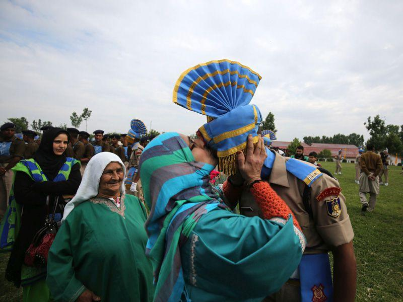 A newly recruit with his relative during the passing out parade in Humhama on the outskirts of Srinagar. Waseem Andrabi/HT