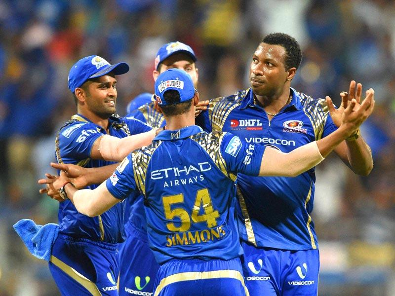 Mumbai Indians (MI) players celebrate their win against Kolkata Knight Riders (KKR) during their IPL 2015 match in Mumbai on May 14. (PTI Photo)