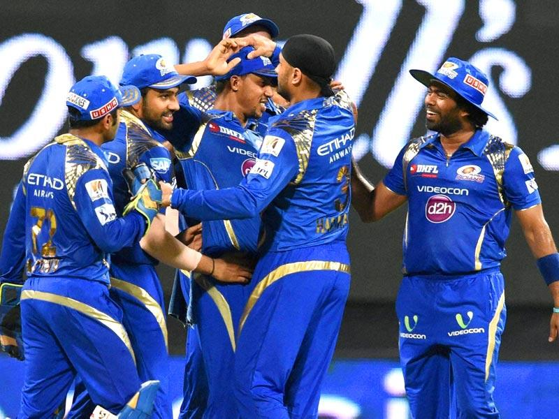 Mumbai Indians (MI) players celebrate the wicket of a Kolkata Knight Riders (KKR) batsman during their IPL 2015 match in Mumbai on May 14. (PTI Photo)