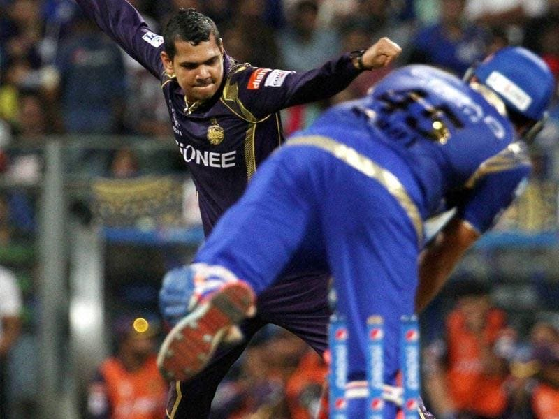 Kolkata Knight Riders' (KKR's) Sunil Narine celebrates the wicket of Mumbai Indians (MI) skipper Rohit Sharma during the IPL 2015 match between the two sides in Mumbai on May 14. (PTI Photo)