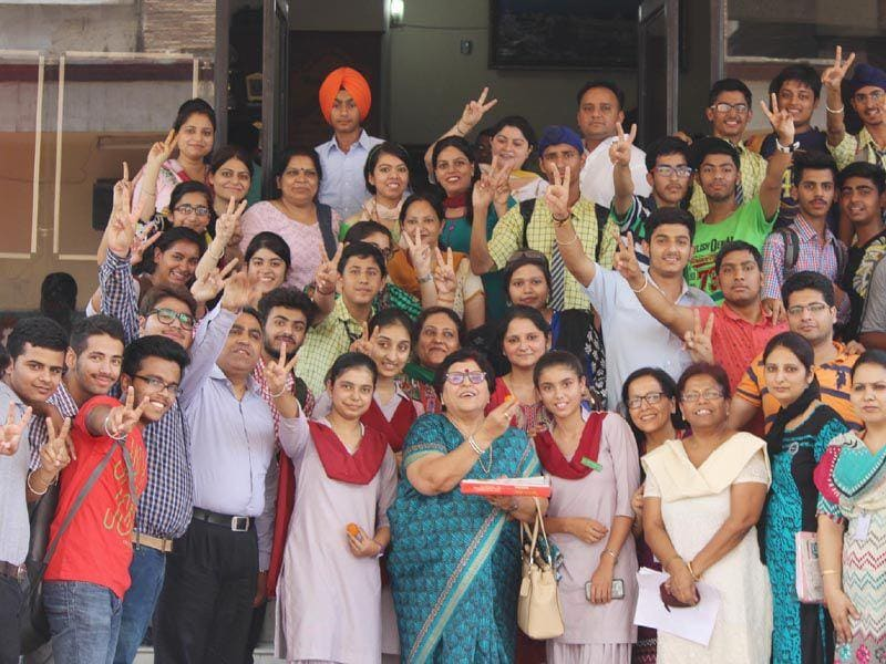 Students of Holy heart presidency school celebrate after class 10th ICSE and class 12th ISC result in Amritsar on Monday. HT/Photo