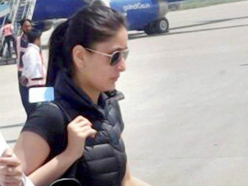 Kareena Kapoor on the way to board her plane at International Airport in Srinagar on Tuesday after shooting for the film Bajrangi Bhaijaan. (PTI Photo)