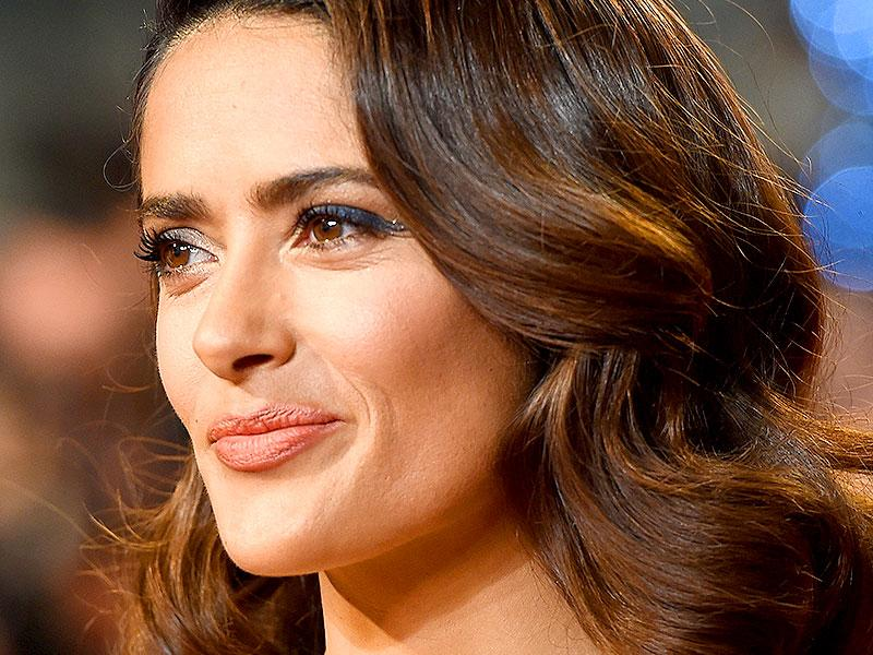 Salma Hayek stunned with charcoal-grey smoky eyes and a peach lip, offset by old school waves.