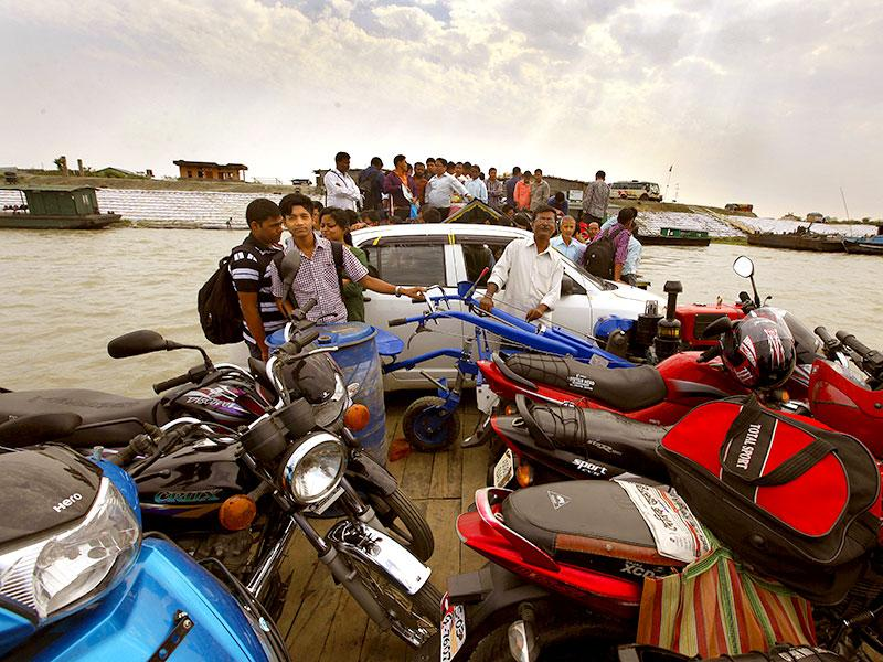 People, cars and bikes pile on ferries to cross the Brahmaputra river to reach the island of Majuli from the mainland in Assam (Photos: Raj K Raj)