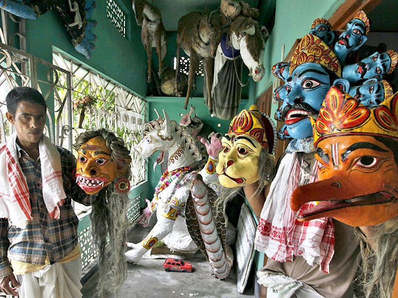 Devotees of Chamoguri Sattra show their handmade masks. The art of mask-making was once prevalent in all sattras across Assam. Now it is practiced in only this sattra