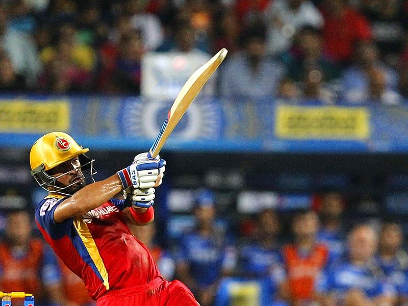 Mandeep Singh backed AB de Villiers to the hilt and punished RR with a blazing, unbeaten 54 off 34 balls to take RCB to a competitive total of 180 in the IPL Eliminator. (Arijit Sen/HT Photo)