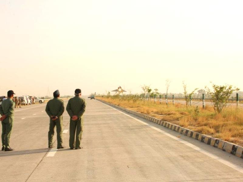 Officials look on as the IAF Mirage-2000 aircraft lands on the Yamuna Expressway during a trial. (IAF Photo)