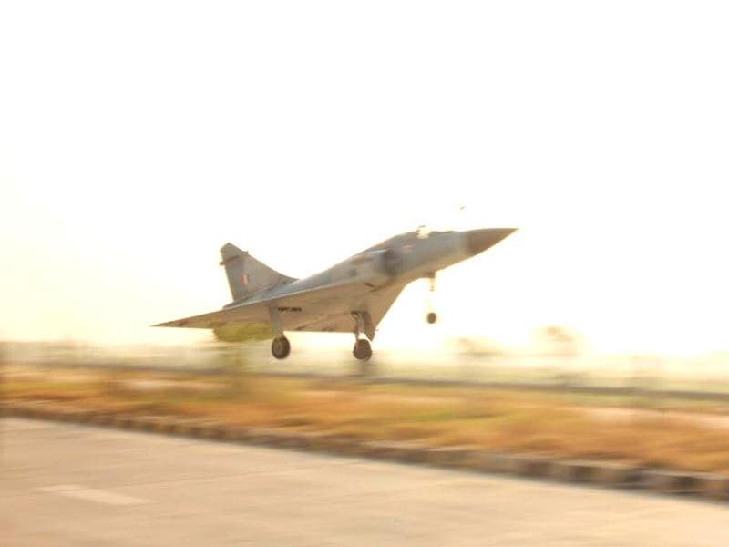 A sunlit Mirage: IAF's Mirage-2000 aircraft lands on the Yamuna Expressway in Uttar Pradesh. (IAF Photo)