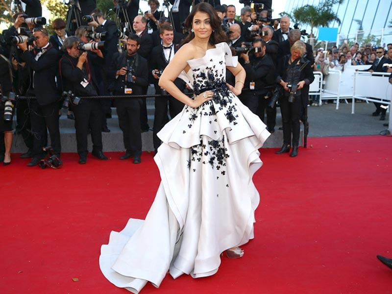 Another day at Cannes, another winning appearance by Aishwarya Rai Bachchan. The former Miss World enamoured us yet again as she walked the red carpet in a white Ralph and Russo gown, one of her more inspired choices. She was seen in a claret Oscar de la Renta on Wednesday and a teal Elie Saab on Sunday. (AFP photo)