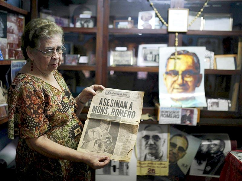 Elvira Chacon, close friend of the late archbishop of San Salvador Oscar Arnulfo Romero shows a newspaper front page report on his assassination, in the city of Santa Tecla, El Salvador. (Reuters)