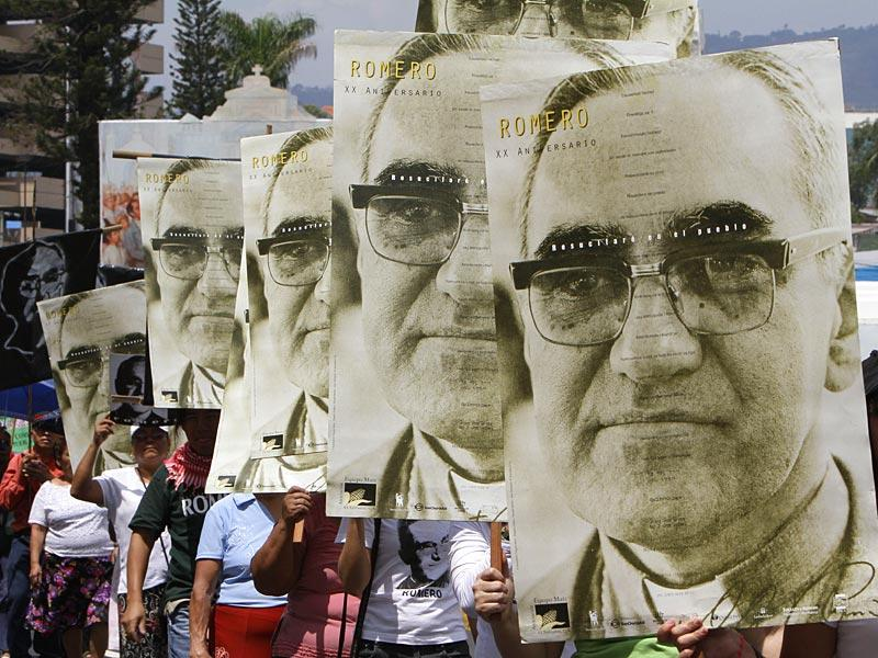 People carry portraits of slain Archbishop Oscar Arnulfo Romero in San Salvador, El Salvador. (AP Photo)