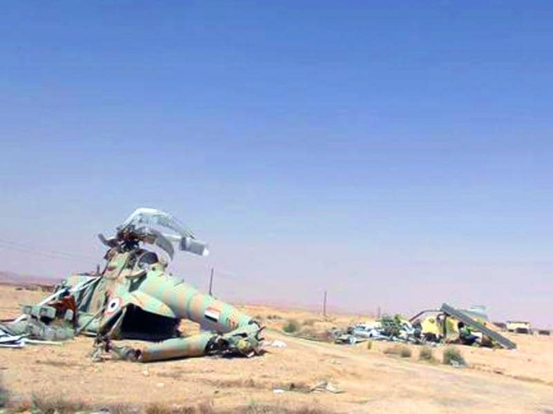 This picture released by the website of Islamic State militants, shows damaged Syrian military helicopters at Palmyra air base. (AP Photo)