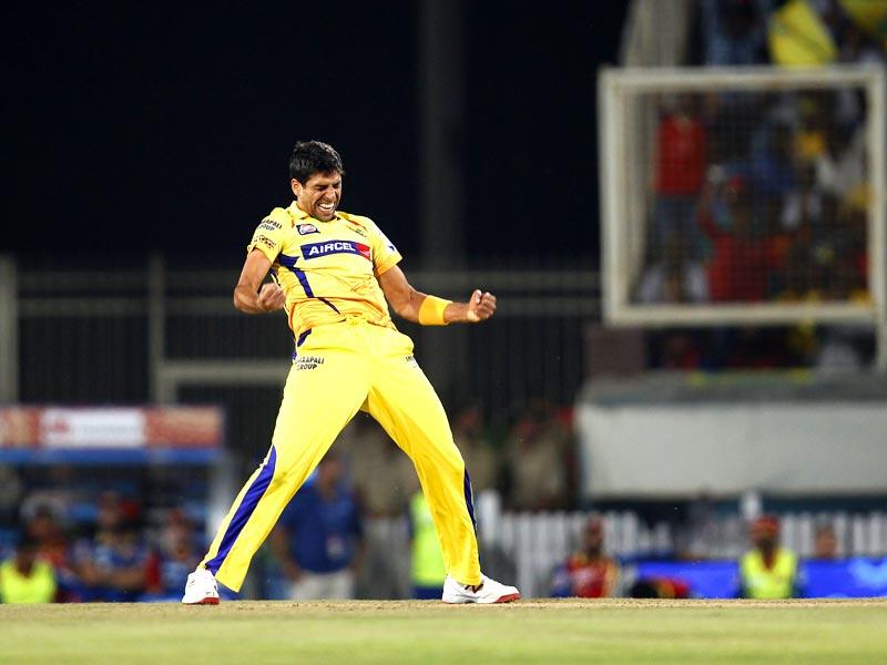 Ashish Nehra of Chennai Super Kings (CSK) celebrates after taking the wicket of a Royal Challengers Bangalore (RCB) batsman during the Indian Premier League (IPL) 2015 Qualifier 2 match between the two sides in Ranchi on May 22. (Ajay Aggarwal/HT Photo)