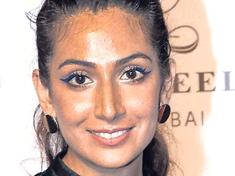 Singer Monica Dogra aces clumpy lashes with a swipe of azure. Get the look by applying mascara in upward and backward strokes. Mark the eyeliner from the center of the lid, flicking it upwards.
