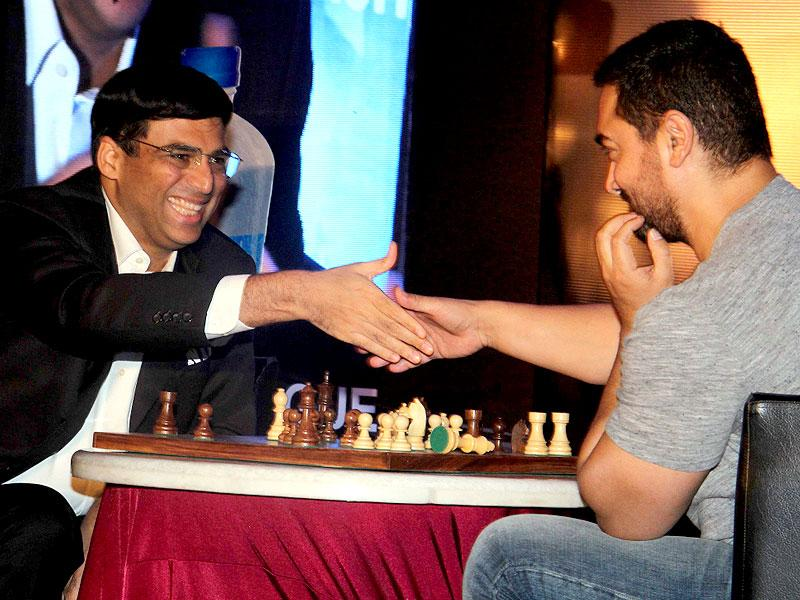 Aamir Khan and Chess World Champion Vishwanathan Anand play the game during the announcement of 3rd Edition of Maharashtra Chess League (MCL), in Mumbai. Aamir said: