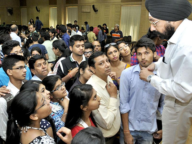 Deputy Dean of Students Welfare Gurpreet Tuteja addressing the students and parents attending the open days session for the new academic session at the Delhi University north campusin, New Delhi. (Photo by Sushil Kumar/ Hindustan Times)