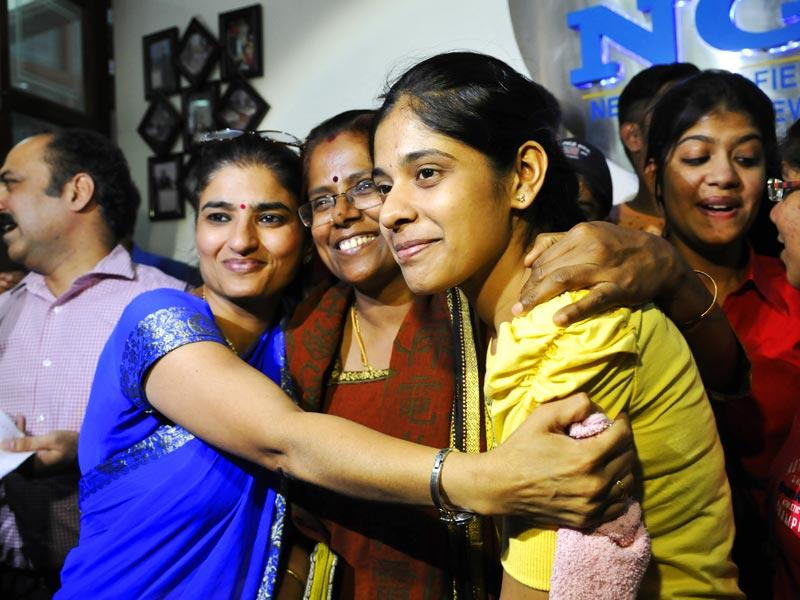 M Gayatri is hugged by the principal of her school (in blue) and her mother at New Green Field School, Saket in New Delhi. She is the all India topper with 99.2% in her Class 12 CBSE examinations. (Photo by Saumya Khandelwal/ Hindustan Times)