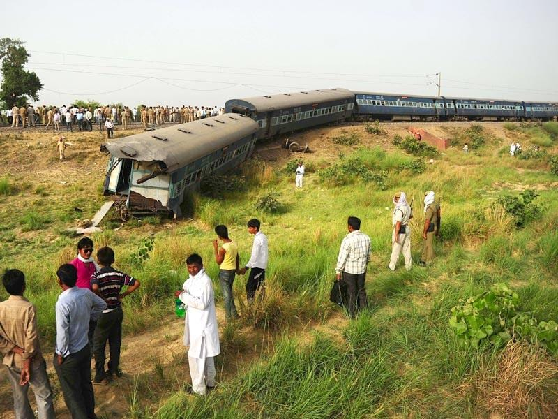 Bystanders look at the coaches of the derailed Muri Express train near Sirathu some 65kms from Allahabad. (AFP Photo)