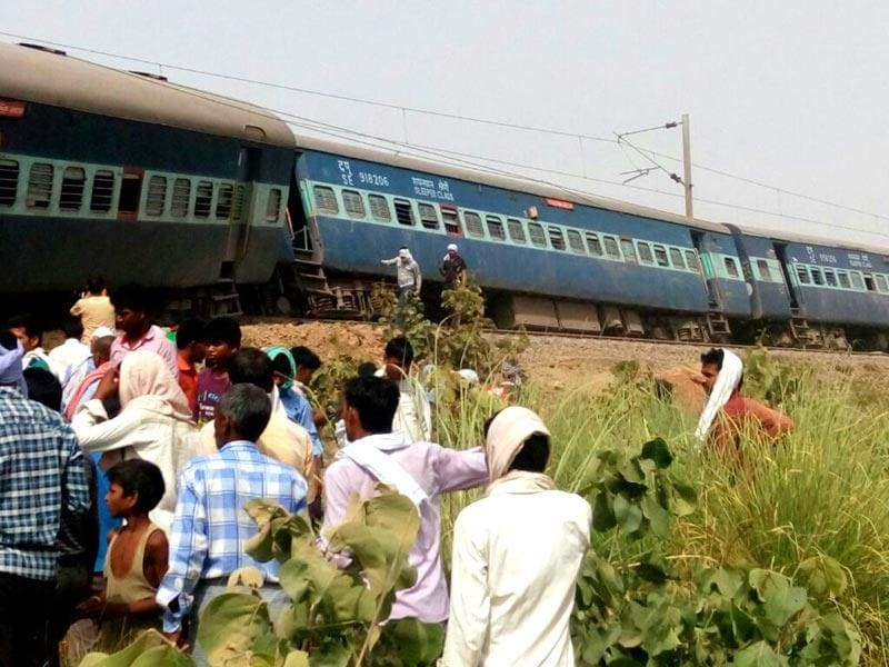 People gather at the accident site. Four people were killed and dozens injured when nine coaches of the Muri Express train derailed near Sirathu in Uttar Pradesh on Monday. (PTI Photo)