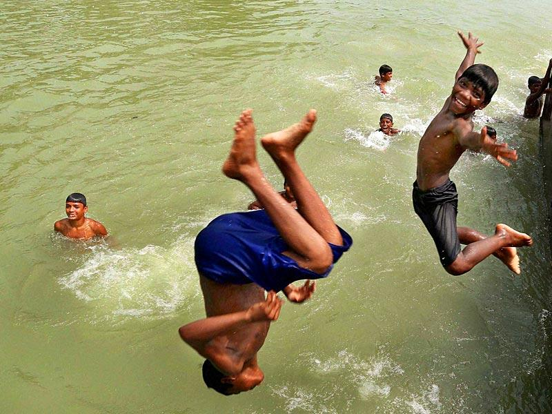 Children jump into the Ganga river to beat the heat on a hot day. Researchers say climate change has pushed up average temperatures across the country by about 1 Celsius, saying the heatwave would intensify in the future. (PTI Photo)