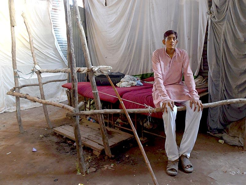 Dharmendra Singh waits to meet people, who pay ten rupees, in a tented enclosure at the fair (AFP Photo)