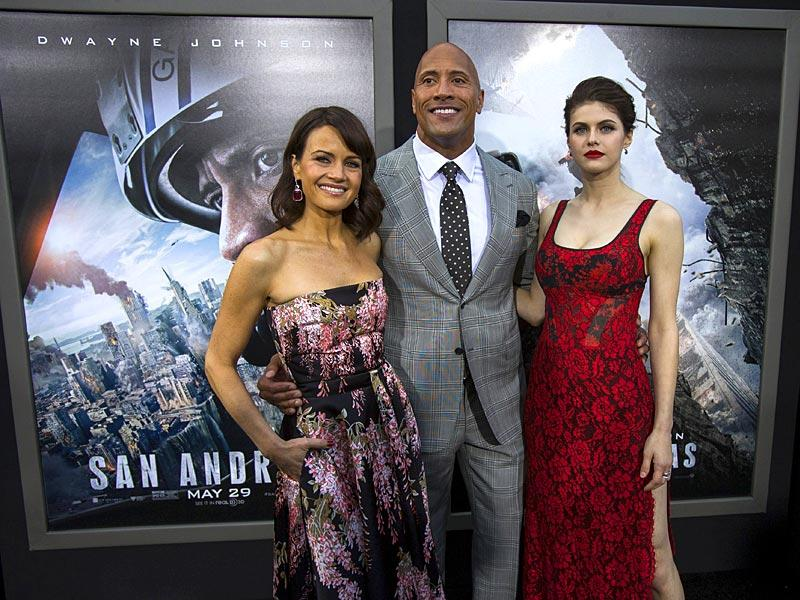 Cast members Dwayne Johnson, Carla Gugino (L) and Alexandra Daddario pose at the premiere of San Andreas in Hollywood. (Reuters)