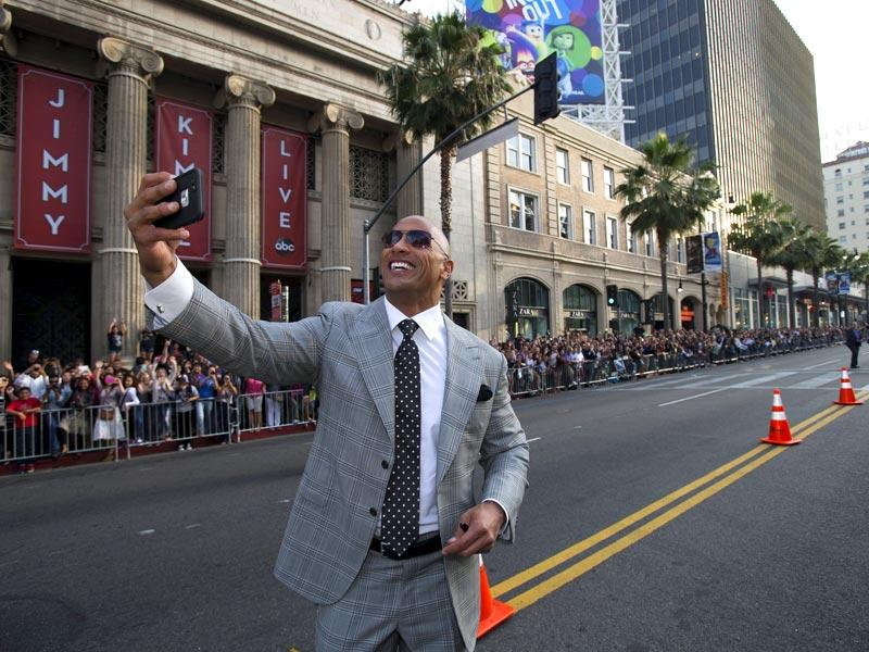 Cast member Dwayne Johnson takes a selfie at the premiere of San Andreas in Hollywood, California. (Reuters)