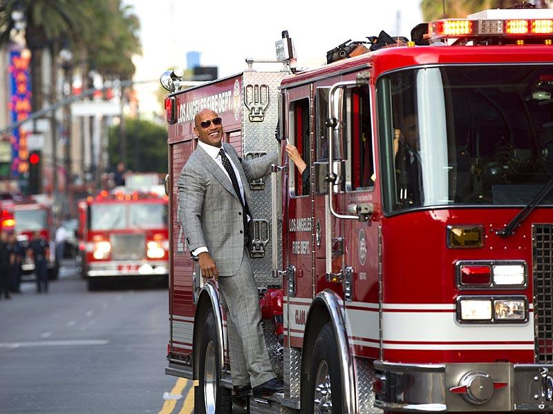 Cast member Dwayne Johnson poses at the premiere of San Andreas in Hollywood. (Reuters)
