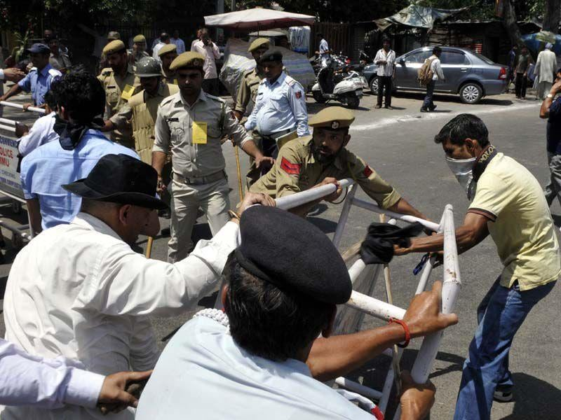 Police personnels trying to stop the crowd during the protest in Jammu. Nitin Kanotra/HT