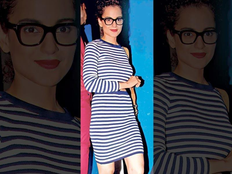 Kangana Ranaut: The actor showed off her geeky chic side with striped separates. A neatly coiffed top-knot and bright red lips complete her look.