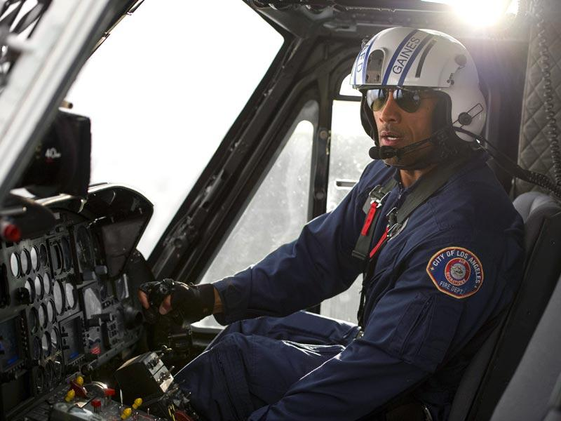 Dwayne Johnson plays a search and rescue pilot in San Andreas.