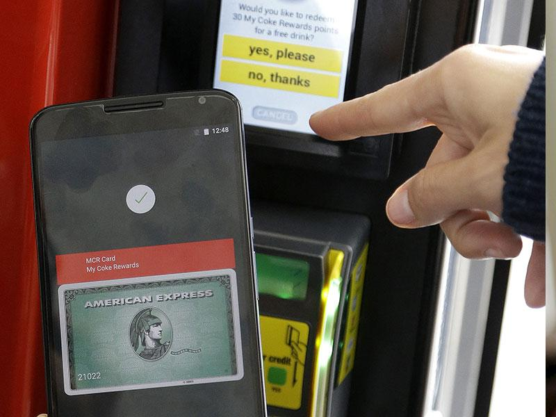 A Google employee gives a demonstration of Android Pay on a phone at Google I/O 2015 in San Francisco. Photo: AP