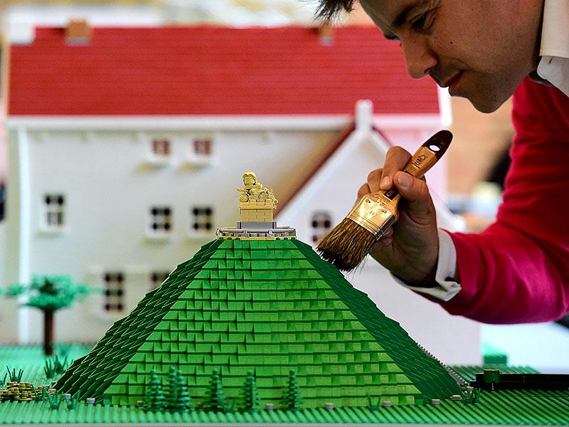 "A Lego bricks replica of La Butte du Lion (The Lion's Hill) , the main memorial monument of the Battle of Waterloo, is prepared prior to the opening of the ""History in Bricks"" exhibition, an exhibition recreating former French emperor Napoleon I life, in Waterloo as part of the celebrations marking the 200th anniversary of The Battle of Waterloo. (AFP PHOTO/Emmanuel Dunand)"