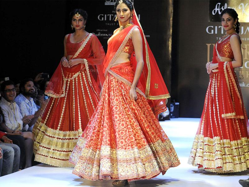 Models walk the ramp at Indore Fashion Week show, in Indore on Saturday. (Shankar Mourya/HT photo)