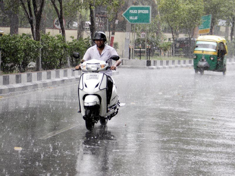 People on road during rainfall in Ludhiana. JS Grewal/HT